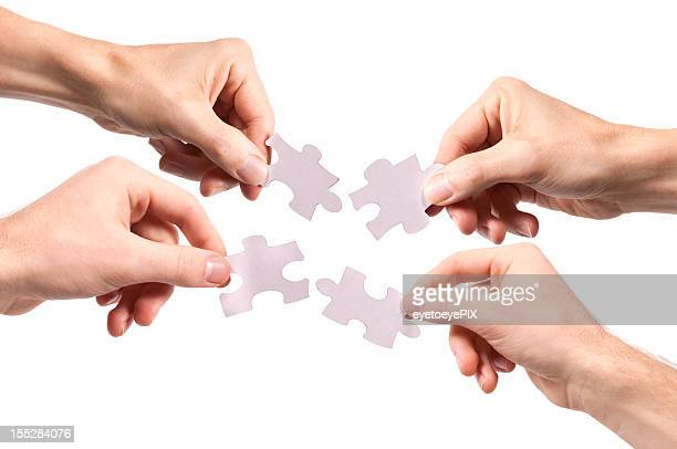 Four People Holding Puzzle