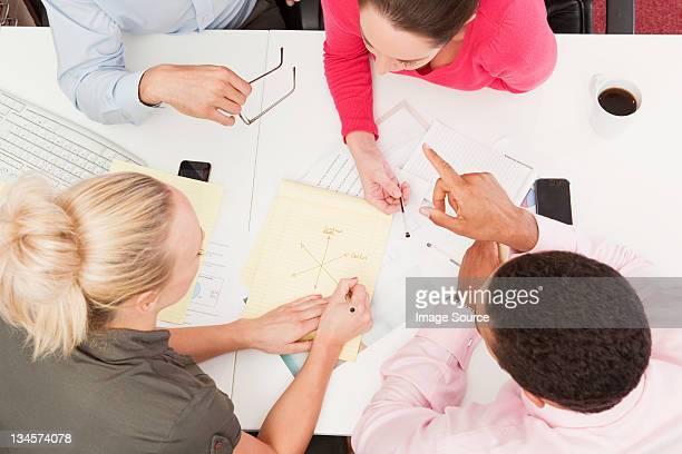 Four people in an informal meeting