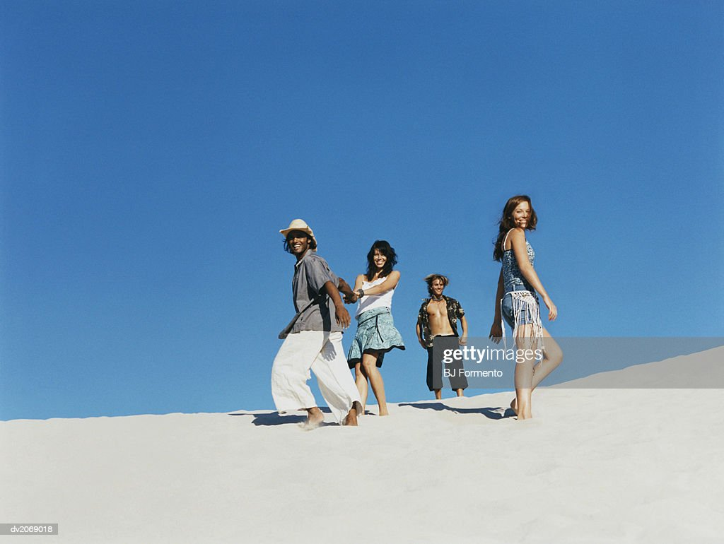 Four People in Summer Outfits : Stock Photo