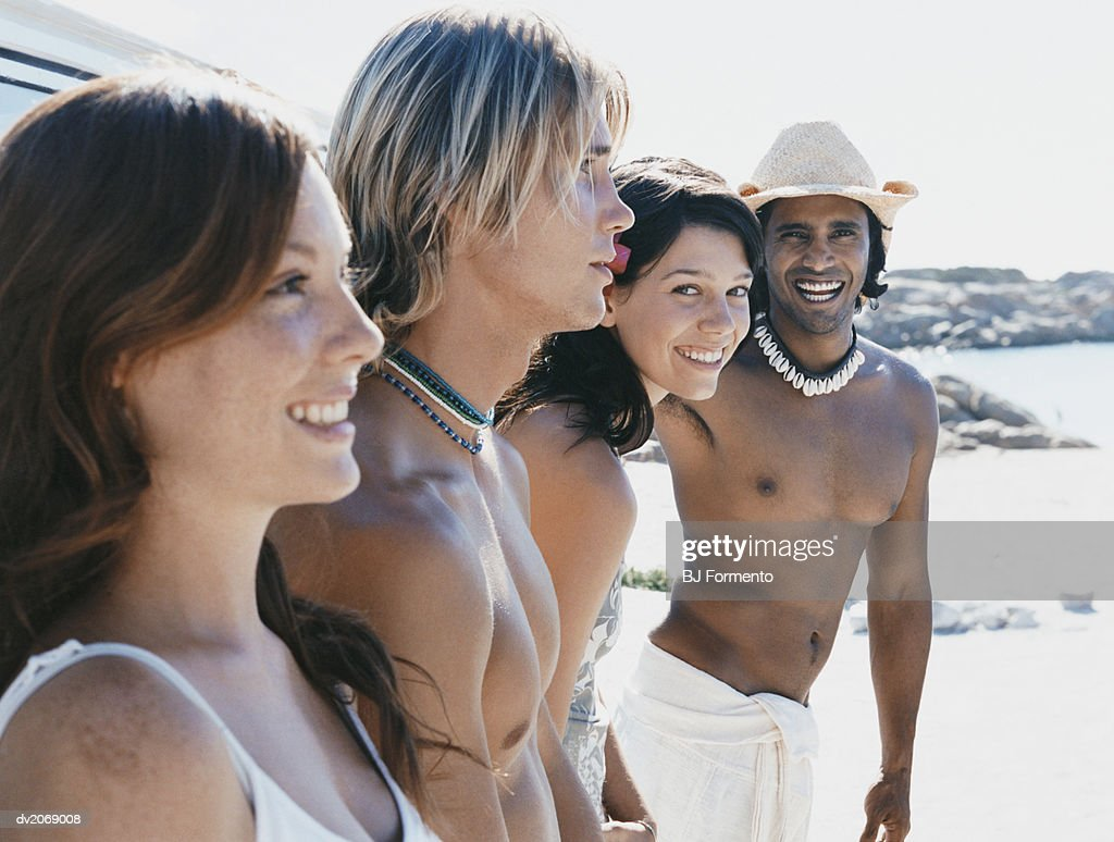 Four people in Summer Outfits Standing Outdoors : Stock Photo