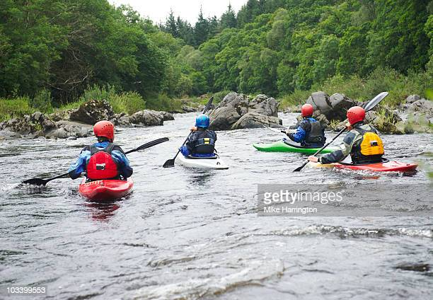 four people kayaking - water sport stock pictures, royalty-free photos & images