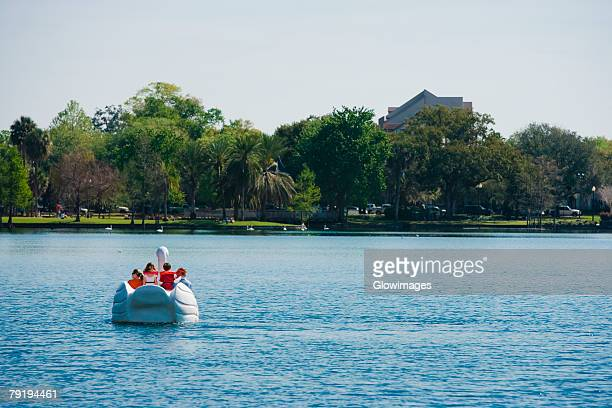 four people on a pedal boat, lake eola park, orlando, florida, usa - swan stock pictures, royalty-free photos & images