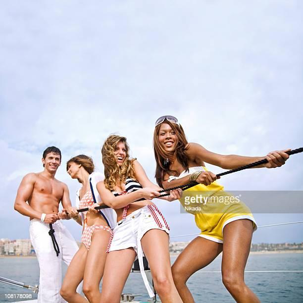 Four People on Catamaran at Sea