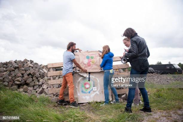 Four people putting up a hand painted target