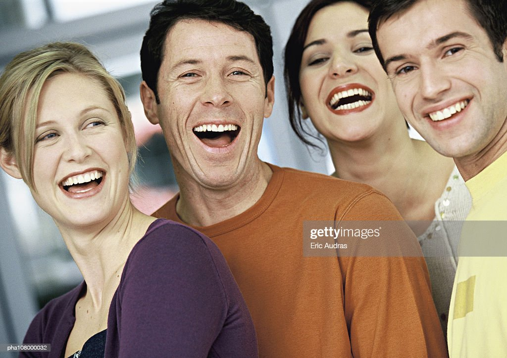 Four people smiling, portrait : Stockfoto