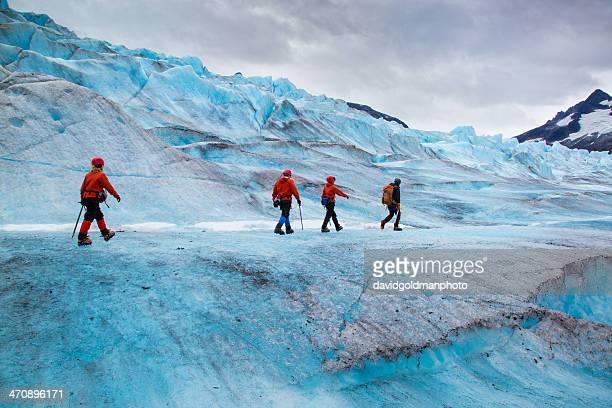 four people walking on mendenhall glacier, alaska, usa - extreme terrain stock pictures, royalty-free photos & images