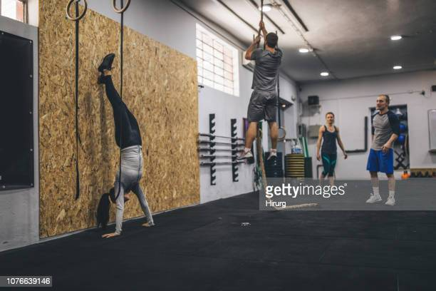 four people working out - circuit training stock photos and pictures