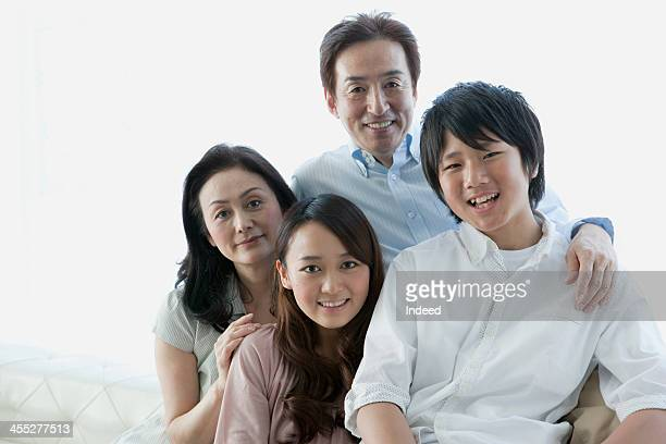 Four person family with good relations