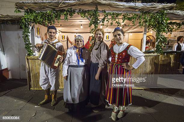 Four persons with the Madeira Island traditional costume poses for the picture in the city during Christmas celebrations on December 29, 2016 in...