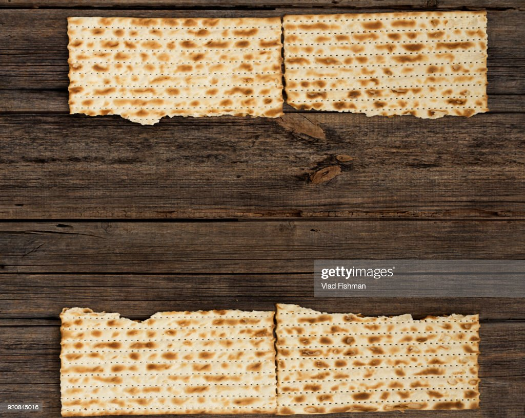 Four pieces of matzah on a vintage wood background with copy space or text space. : Stock Photo