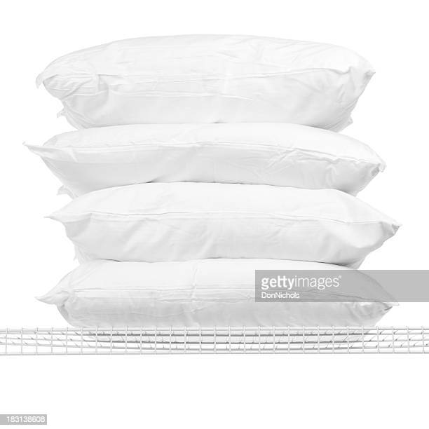 Four Pillows on Shelf