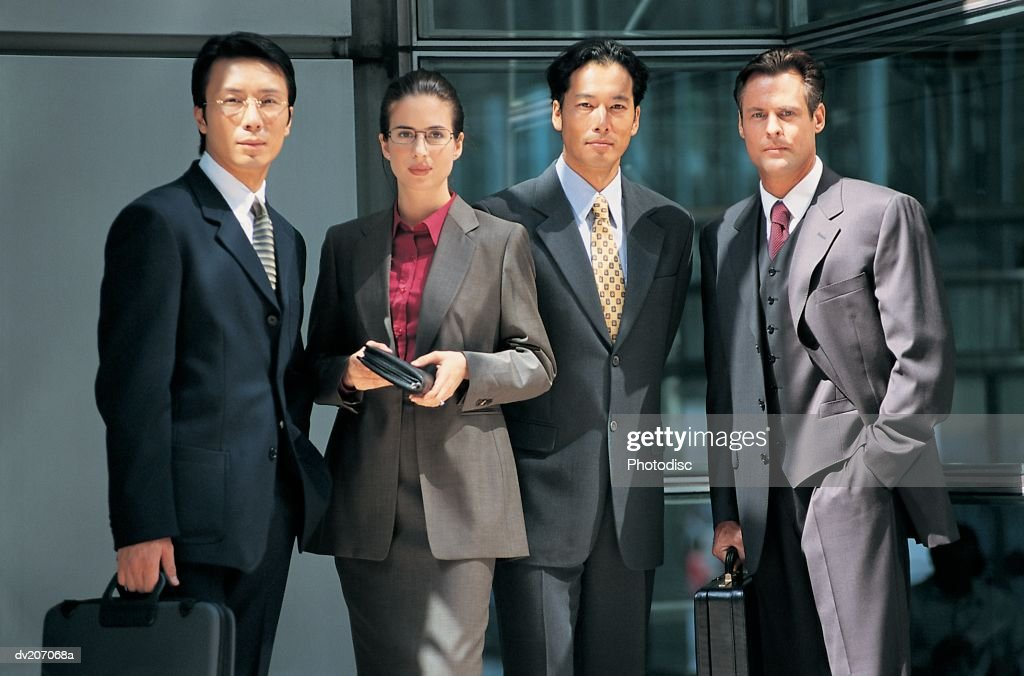 Four professionals standing outside : Stock Photo