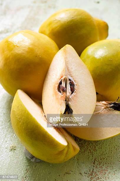 Four quinces, one cut into pieces