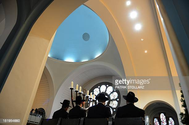 Four rabbis attend the ceremony of their ordination at the synagogue in Cologne western Germany on September 13 2012 The ordination of the four...