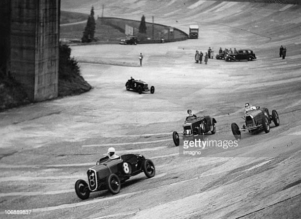 Four racing cars speeding at the race track Weybridge England Photograph March 29h 1937