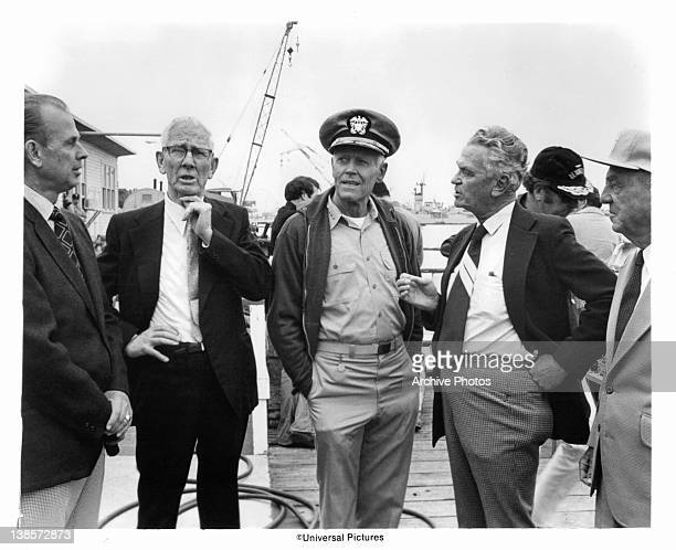 Four real heroes of the battle of Midway are standing with Henry Fonda in a scene from the film 'Midway' 1976