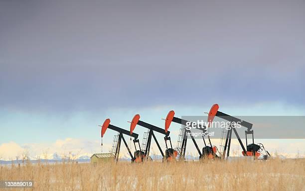 Four Red Oil Field Pumpjacks in Alberta