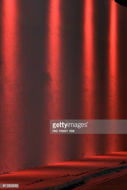 Four red Spotlights on a wall