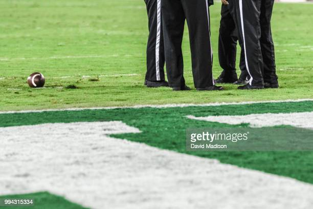four referees consult during american football game - american football referee stock pictures, royalty-free photos & images