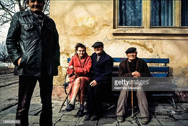 Four residents at a country 'retirement' home and hospital outside Ciutelec in Bihor County Romania. This image was taken a few months after the...