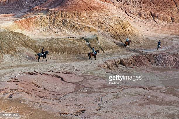 four riders in morocco desert - foothills stock pictures, royalty-free photos & images