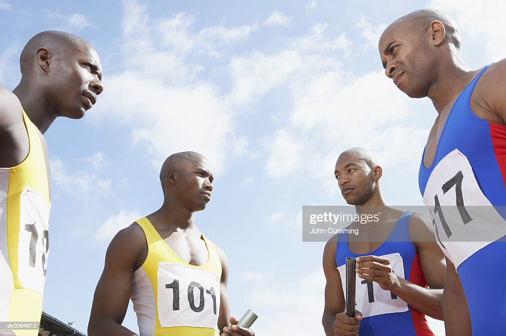 Four Rival Athletes Staring at Each Other : Stock Photo