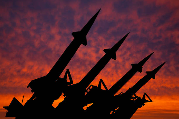 four rockets of anti-aircraft missile system are directed upwards against the background of sunset - 俄羅斯 個照片及圖片檔