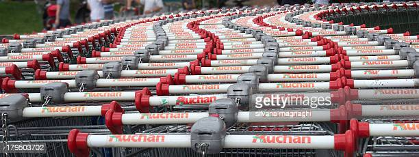 CONTENT] Four rows of shopping carts outside a supermarket in an Italian shopping center