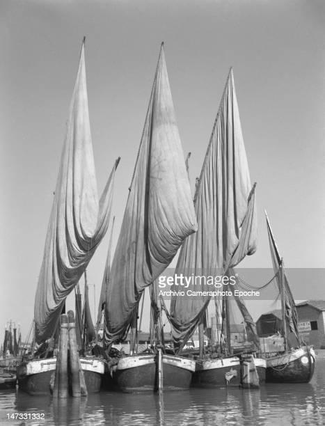 Four sail boats docking in Chioggia Venice 1950