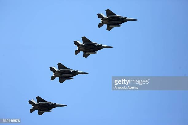 Four Saudi fighter jets which will support the coalition forces as part of the fight against Daesh are seen in the sky before they land at Incirlik...