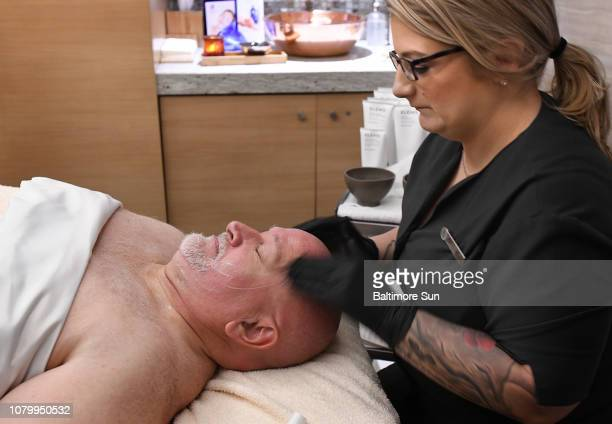 Four Seasons esthetician Cristy Brenneman applies a variety of skin care products as part of a facial treatment for cancer patient Charlie Yommer