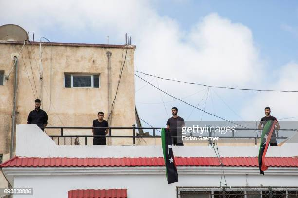 Four security persons stand on a building of a Detention Center on June 08 2017 in Tripolis Libya A detention center place where illegal migrants are...