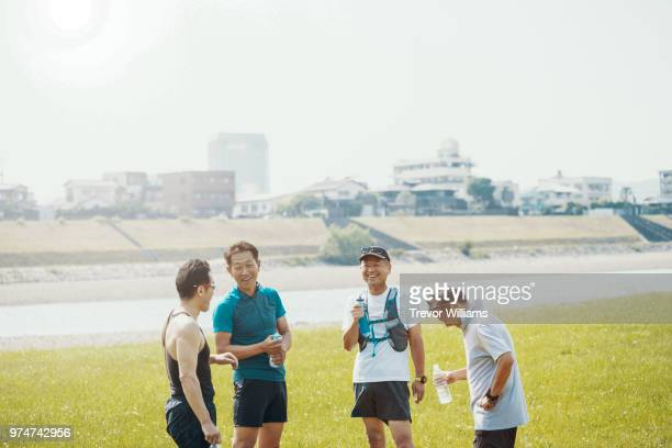 four senior adults after running together - 絆 ストックフォトと画像