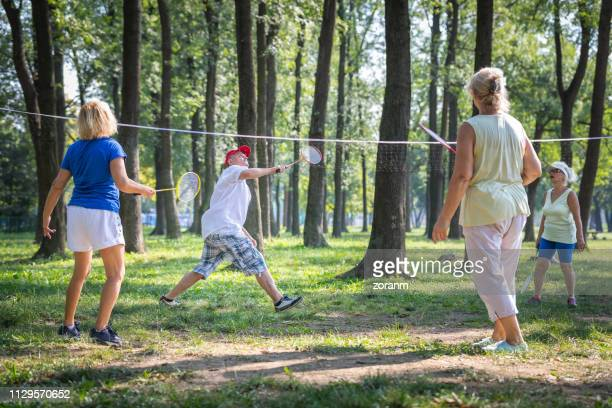 four seniors playing badminton - badminton stock pictures, royalty-free photos & images