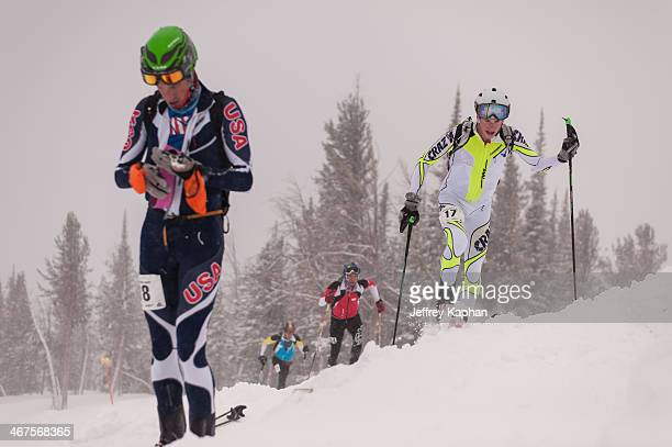 CONTENT] Four ski mountaineering racers during a race at the Jackson Hole Mountain Resort Three are on ski's and one is in transition rolling up his...