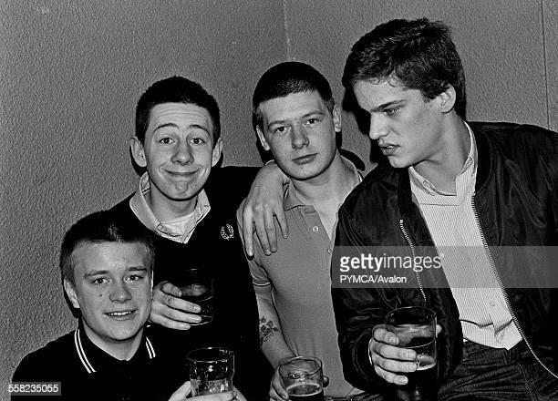 Four skinshead Mods at a gig 1981