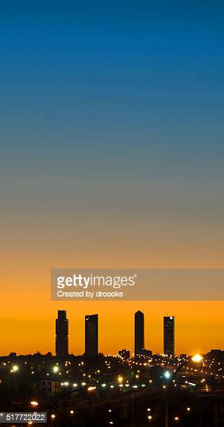Four skyscrapers against sunset