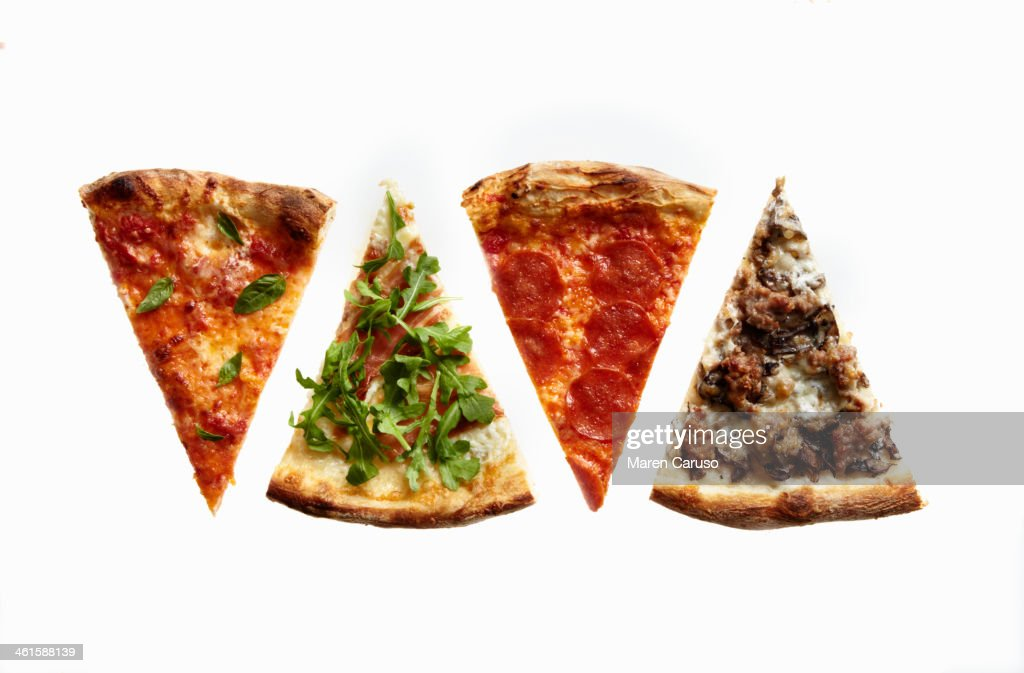 Four Slices of Pizza with Variety of Toppings : Stock Photo