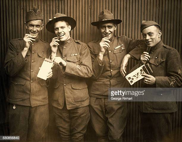 Four slodiers in WWI uniforms pose eating Maillard's Eagle Sweet Chocolate. An eagle is illustrated on the candy bar wrapping.