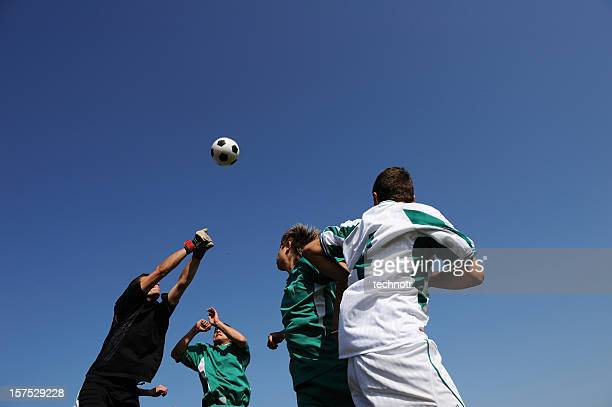 vier fußballspieler in aktion - kopfschuss stock-fotos und bilder