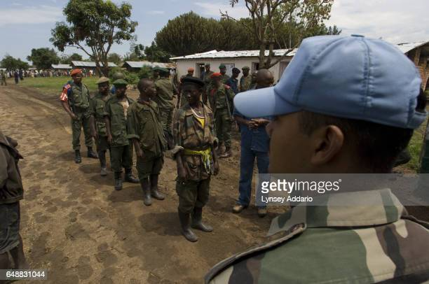 Four soldiers with the Rally for Unity Democracy RUD a dissident faction of the Rwandanled Hutu militia known as the FDLR surrender to UN and...