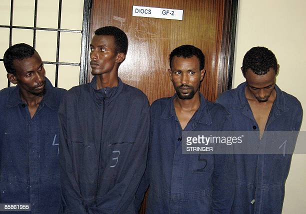 Four Somali pirates who were among seven accused of firing on a German ship off the coast of Yemen are pictured on April 082009 in a Kenyan police...