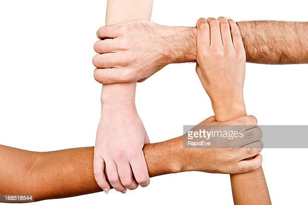 four square! interracial hands linked in unity - four people stock pictures, royalty-free photos & images