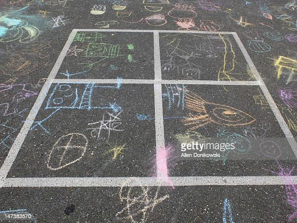 Four square parking lot chalk drawings