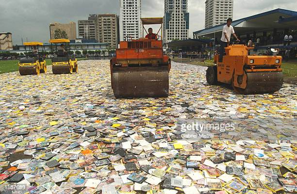 Four steamrollers crush approximately two million illegal video CDs DVDs and cassettes of local and foreign films during a ceremony highlighting the...