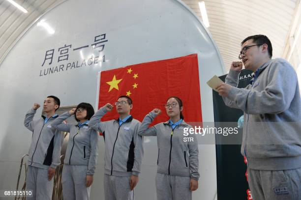 Four student volunteers take an oath before entering the Lunar Palace 1 a laboratory simulating a lunarlike environment for an initial 60day stay in...