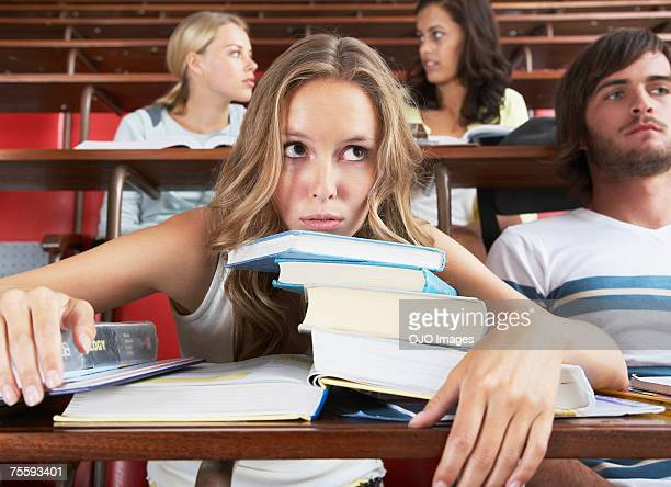 four students in a classroom - educational subject stock photos and pictures