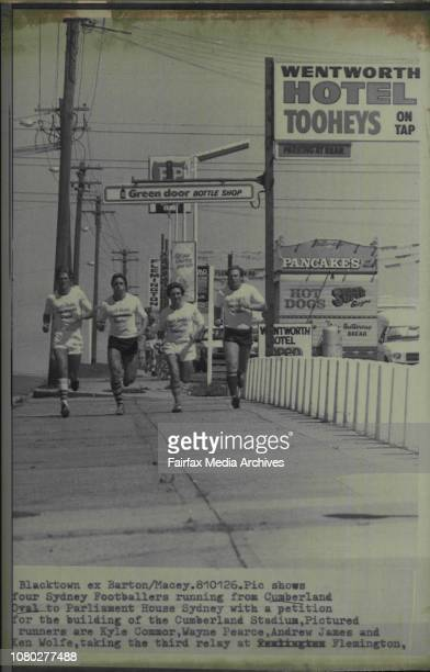 Four Sydney Footballers running from Cumberland Oval to Parliament House Sydney with a petition for the building of the Cumberland Stadium Pictured...