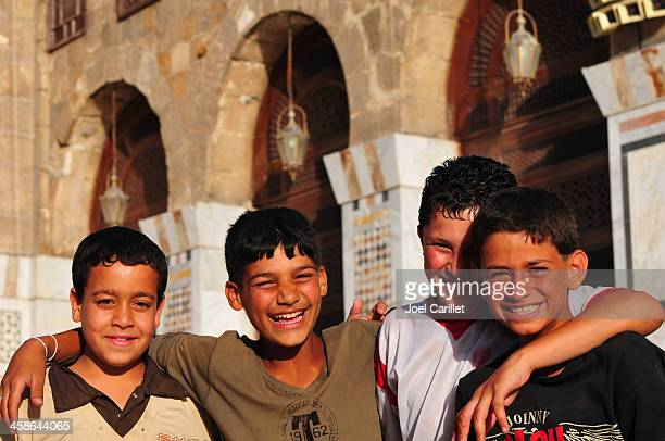 syrian boys in the umayyad mosque at damascus - syria stock pictures, royalty-free photos & images