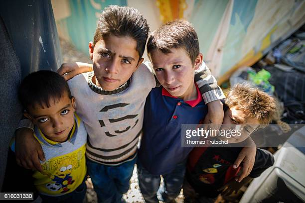 Four Syrian boys posing in a refugee camp in the Bekaa plain for a photo on October 06 2016 in Bar Elias Lebanon